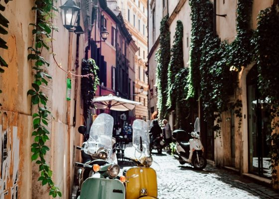 Scooters on the street in Rome photo by Andrei Mike, Unsplash